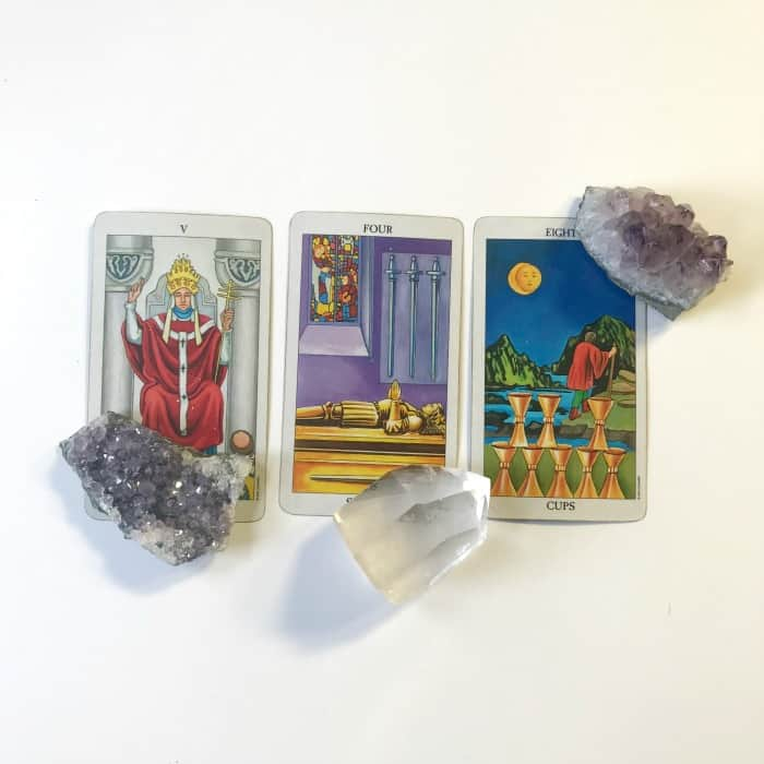 Tarot and Crystals and Rituals…oh my! A primer for working with Tarot and Crystals. Laying crystals on tarot cards
